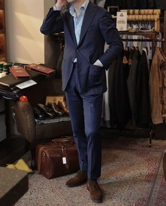 How to Wear Dark Brown Suede Desert Boots: The sartorial arsenal of any discerning gent should always include such essentials as a navy suit and a light blue vertical striped dress shirt. Our favorite of a myriad of ways to complement this look is with dark brown suede desert boots.
