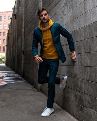How to wear: navy suit, mustard hoodie, white crew-neck t-shirt, white leather low top sneakers