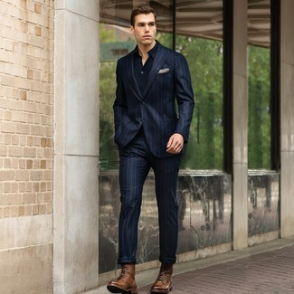 How to Wear a Navy Vertical Striped Suit: Breathe personality into your daily routine with a navy vertical striped suit and a navy polo. Add brown leather casual boots to the mix and ta-da: the getup is complete.