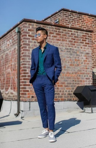 1200+ Smart Casual Outfits For Men: Try teaming a navy check suit with a teal dress shirt for a really stylish outfit. When this look is too much, play it down by rounding off with grey canvas low top sneakers.