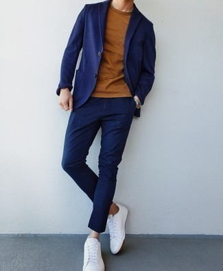 Tobacco Crew-neck T-shirt Outfits For Men: For an effortlessly classic outfit, try pairing a tobacco crew-neck t-shirt with a navy suit — these two items fit nicely together. Serve a little outfit-mixing magic by finishing with white leather low top sneakers.