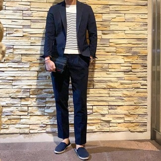 How to wear: navy suit, white and navy horizontal striped crew-neck sweater, navy canvas slip-on sneakers, navy leather watch