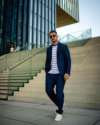 How to wear: navy suit, white and navy horizontal striped crew-neck t-shirt, white leather low top sneakers, black sunglasses