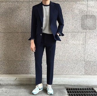 How to Wear a Navy Suit: When the dress code calls for a classy yet cool outfit, go for a navy suit and a white and navy horizontal striped long sleeve t-shirt. Light blue suede low top sneakers will bring an easy-going feel to an otherwise classic look.