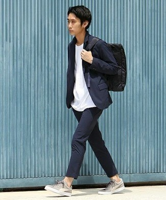 How to Wear a Black Canvas Backpack For Men: For a casually cool ensemble, make a navy suit and a black canvas backpack your outfit choice — these two items play beautifully together. If you're clueless about how to finish, a pair of grey canvas low top sneakers is a savvy choice.
