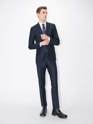 How to wear: navy suit, white dress shirt, black leather chelsea boots, navy print tie