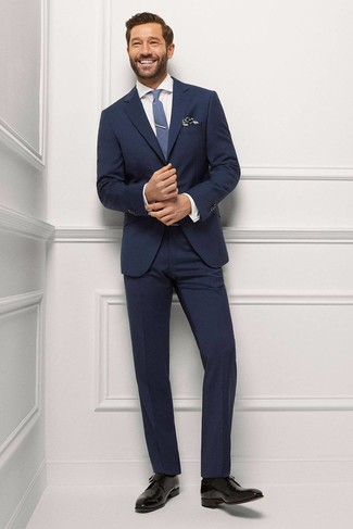 How to wear: navy suit, white dress shirt, black leather derby shoes, blue tie