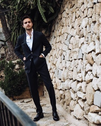 How to Wear Black Leather Dress Boots For Men: A navy suit and a white dress shirt are powerful sartorial weapons in any gent's wardrobe. When in doubt as to what to wear on the shoe front, go with a pair of black leather dress boots.