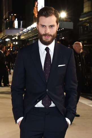 Jamie Dornan wearing Navy Suit, White Dress Shirt, Dark Purple Print Tie, White Pocket Square