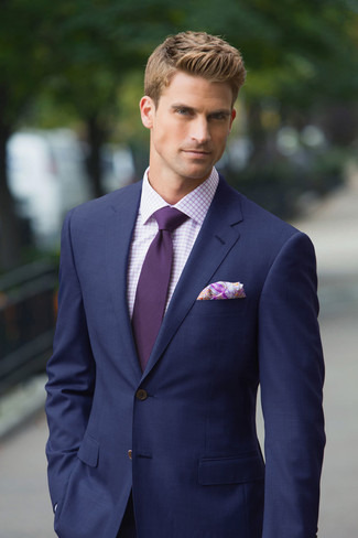 How to Wear a Dark Purple Tie For Men: One of the most elegant ways to style out such a hard-working menswear piece as a navy suit is to pair it with a dark purple tie.