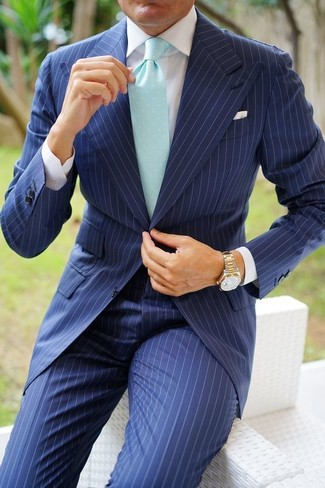 How to wear: navy vertical striped suit, white dress shirt, mint tie, gold watch
