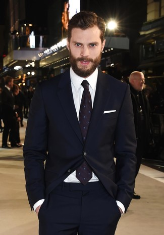 Jamie Dornan wearing Navy Suit, White Dress Shirt, Navy Polka Dot Tie, White Pocket Square