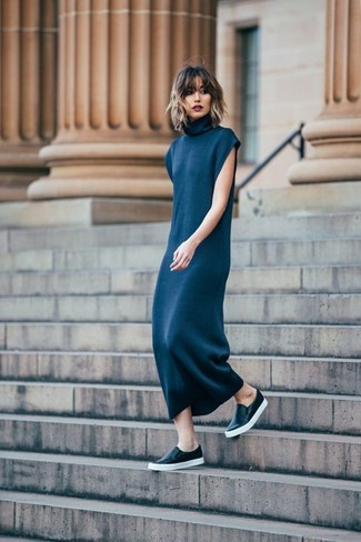 Opt for dark blue sweater dress for a lazy Sunday brunch. Black leather slip-on sneakers will instantly smarten up even the laziest of looks.