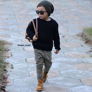 How to wear: navy sweater, grey jeans, tan boots, charcoal beanie