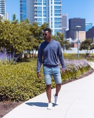 Navy Sweatshirt Outfits For Men: This laid-back pairing of a navy sweatshirt and light blue ripped denim shorts is simple, on-trend and extremely easy to replicate. Breathe a hint of sophistication into this getup by wearing a pair of white canvas low top sneakers.