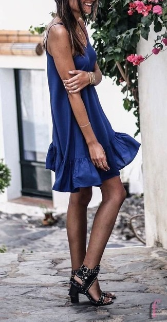 How to wear: navy swing dress, black studded leather heeled sandals, gold bracelet