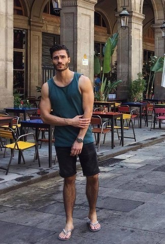 How to Wear Black Shorts For Men: A navy tank and black shorts have become true casual styles. Rev up your whole getup by sporting a pair of silver flip flops.