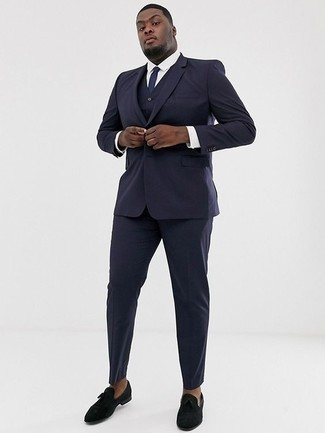 How to Wear a Navy Three Piece Suit: This classy pairing of a navy three piece suit and a white dress shirt is a common choice among the dapper gentlemen. Let your outfit coordination expertise truly shine by rounding off this ensemble with black velvet loafers. The ability to wear ensembles like this is one of the advantages of stepping into your 30s.