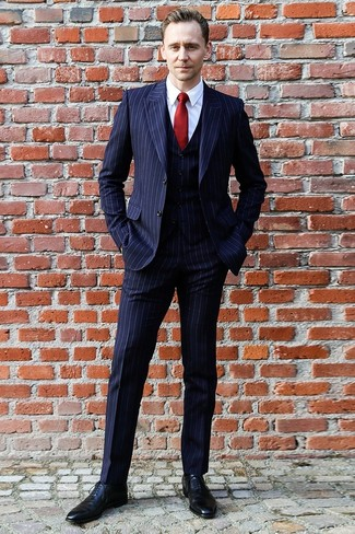 How to wear: navy vertical striped three piece suit, white dress shirt, black leather oxford shoes, red silk tie