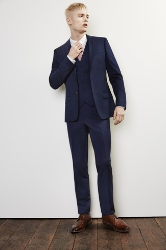 How to wear: navy three piece suit, white dress shirt, brown leather brogues, pink tie