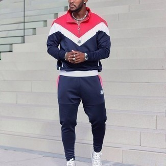 Track Suit Outfits For Men: Dapper yet practical, this ensemble features a track suit. And if you want to easily class up this ensemble with a pair of shoes, introduce grey print canvas high top sneakers to the mix.