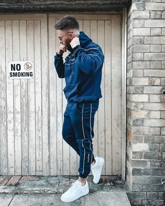 Navy Track Suit Outfits For Men: Choose a navy track suit for a relaxed and trendy look. Avoid looking too casual by finishing off with white leather low top sneakers.