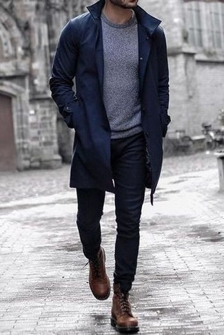 Black Jeans Outfits For Men: A navy trenchcoat and black jeans are the ideal way to inject some elegance into your casual arsenal. Complete this outfit with a pair of brown leather casual boots for maximum style points.