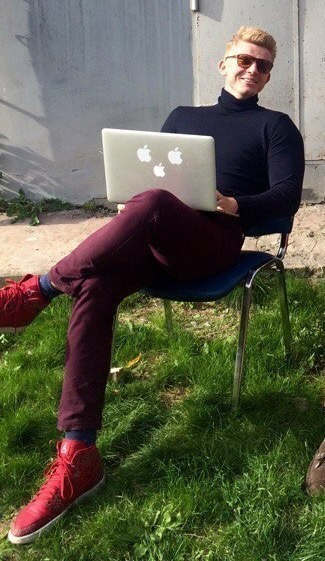 Alexander Zaytsev wearing Navy Turtleneck, Burgundy Jeans, Red Leather High Top Sneakers, Navy Socks