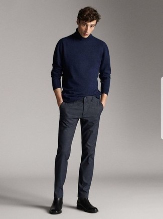 Boots Outfits For Men: Super stylish, this casual combination of a navy turtleneck and charcoal chinos will provide you with excellent styling possibilities. Add a pair of boots to your ensemble for extra fashion points.
