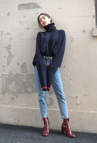 How to wear: navy knit turtleneck, light blue jeans, burgundy leather ankle boots, black leather belt