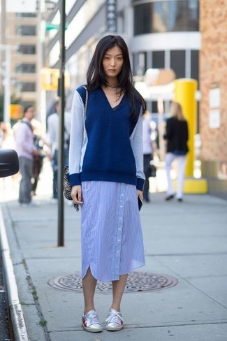 How to wear: navy v-neck sweater, blue vertical striped shirtdress, silver leather low top sneakers