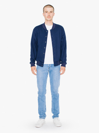 How to wear: navy varsity jacket, white crew-neck t-shirt, light blue jeans, white low top sneakers