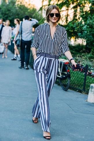 Olivia Palermo wearing Navy Vertical Striped Dress Shirt, Light Blue Vertical Striped Wide Leg Pants, Black Suede Heeled Sandals