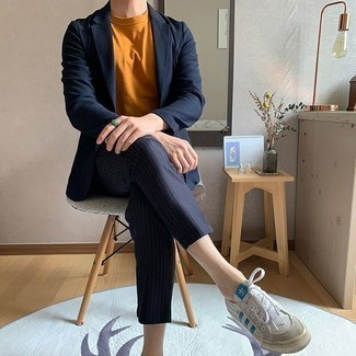 Tobacco Crew-neck T-shirt Outfits For Men: This pairing of a tobacco crew-neck t-shirt and a navy vertical striped suit looks sophisticated, but in a modern way. Hesitant about how to finish? Complete this look with white and blue canvas low top sneakers for a more laid-back vibe.