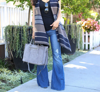 How to wear: navy horizontal striped wool vest, black tank, blue flare jeans, grey leather tote bag