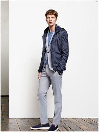 Pairing a windbreaker and a grey suit will create a powerful and confident silhouette. Choose a pair of navy suede slip-on sneakers for a more relaxed feel. Seeing as fall is fast approaching, this look seems a smart choice for the transitional season.