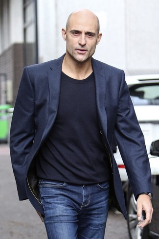 Mark Strong wearing Navy Wool Blazer, Navy Crew-neck Sweater, Blue Jeans