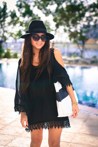 How to wear: black silk off shoulder dress, white and black leather tote bag, black wool hat, black sunglasses