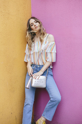 How to wear: multi colored vertical striped off shoulder top, light blue jeans, white leather gladiator sandals, silver leather crossbody bag