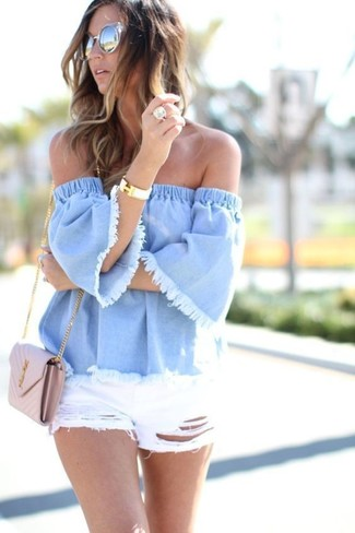 A light blue denim off shoulder top and white ripped denim shorts are a perfect combination to be utilised at the weekend.