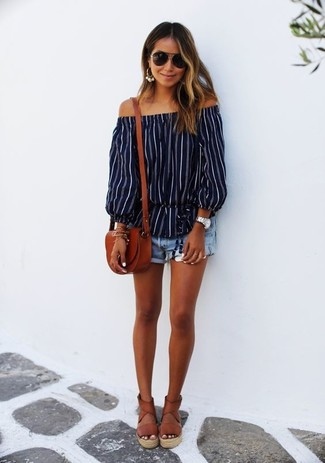 How to Wear Brown Leather Espadrilles For Women: Why not wear a navy vertical striped off shoulder top and light blue denim shorts? Both of these pieces are very comfortable and look wonderful when worn together. Introduce brown leather espadrilles to the mix and ta-da: this ensemble is complete.