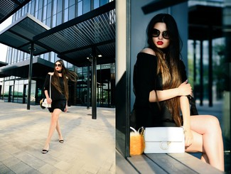 Pair a black off shoulder top with black shorts for a casual get-up. A cool pair of black leather wedge sandals is an easy way to upgrade your look.