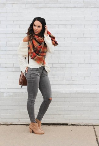 How to wear: white knit off shoulder top, grey ripped skinny jeans, tan leather ankle boots, brown leather crossbody bag