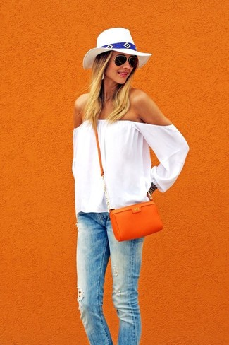 Dress in a white off shoulder top and light blue ripped skinny jeans for a casual coffee run.