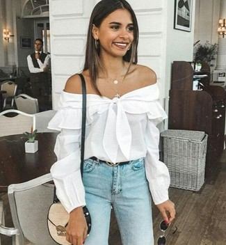 How to wear: white off shoulder top, light blue skinny jeans, beige leather crossbody bag, black leather belt