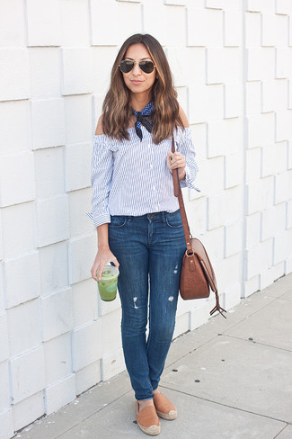 Consider teaming a blue striped off shoulder top with blue skinny jeans for a lazy day look. For the maximum chicness throw in a pair of khaki leather espadrilles.