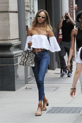 Jourdan Dunn wearing White Eyelet Off Shoulder Top, Navy Skinny Jeans, Brown Leather Heeled Sandals, Grey Snake Leather Tote Bag