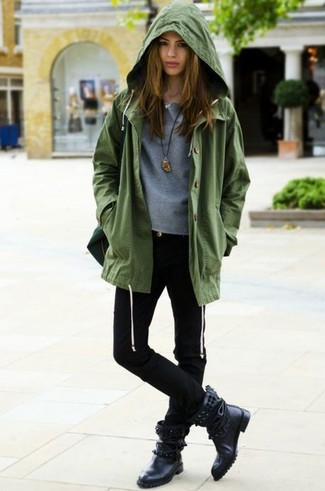 How to wear: olive anorak, grey crew-neck sweater, black skinny jeans, black studded leather mid-calf boots