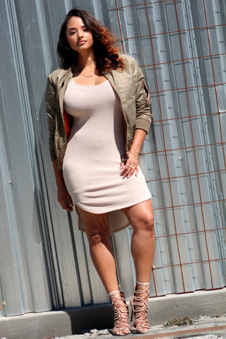 Marry an olive bomber with a cream knit bodycon dress to get a laid-back yet stylish look. A pair of beige suede heeled sandals will add more polish to your overall look.  On not-so-bone-chilling afternoons, wear this easy-to-transition look and look absolutely amazing.