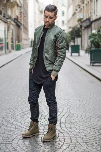 How to wear: olive bomber jacket, black crew-neck t-shirt, black skinny jeans, olive suede work boots